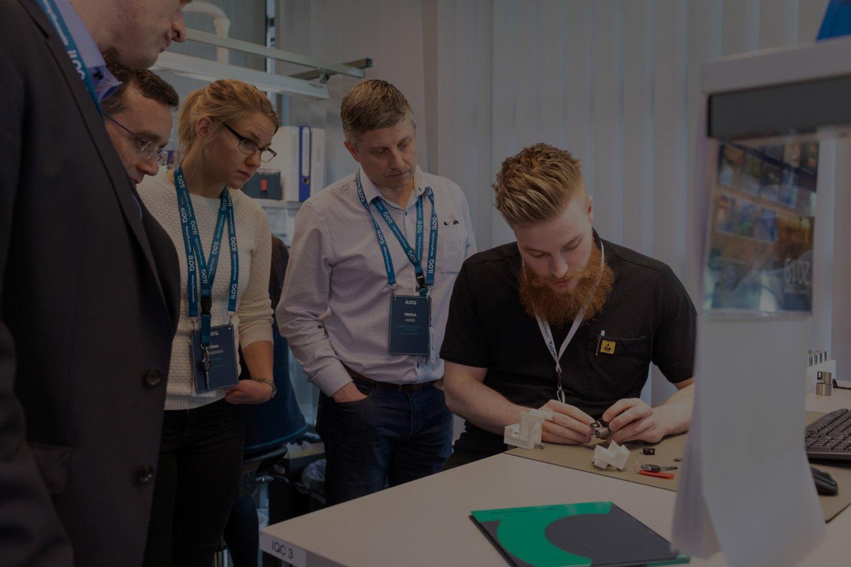 iLOQ Careers man presenting iLOQ products